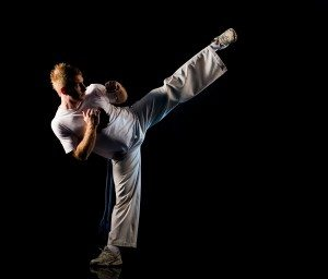 Man in dark practice martial art - high kick