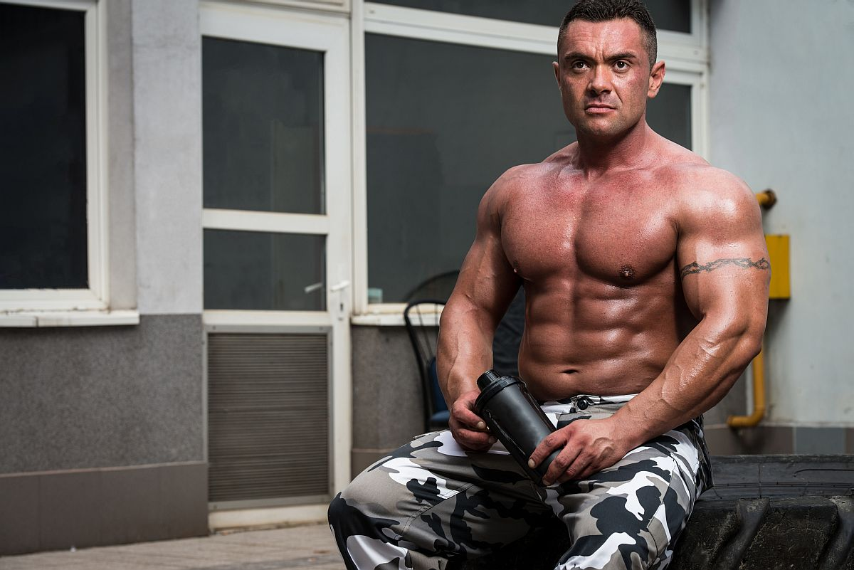 Bodybuilder Resting And Drinking Protein Shake After Exercising