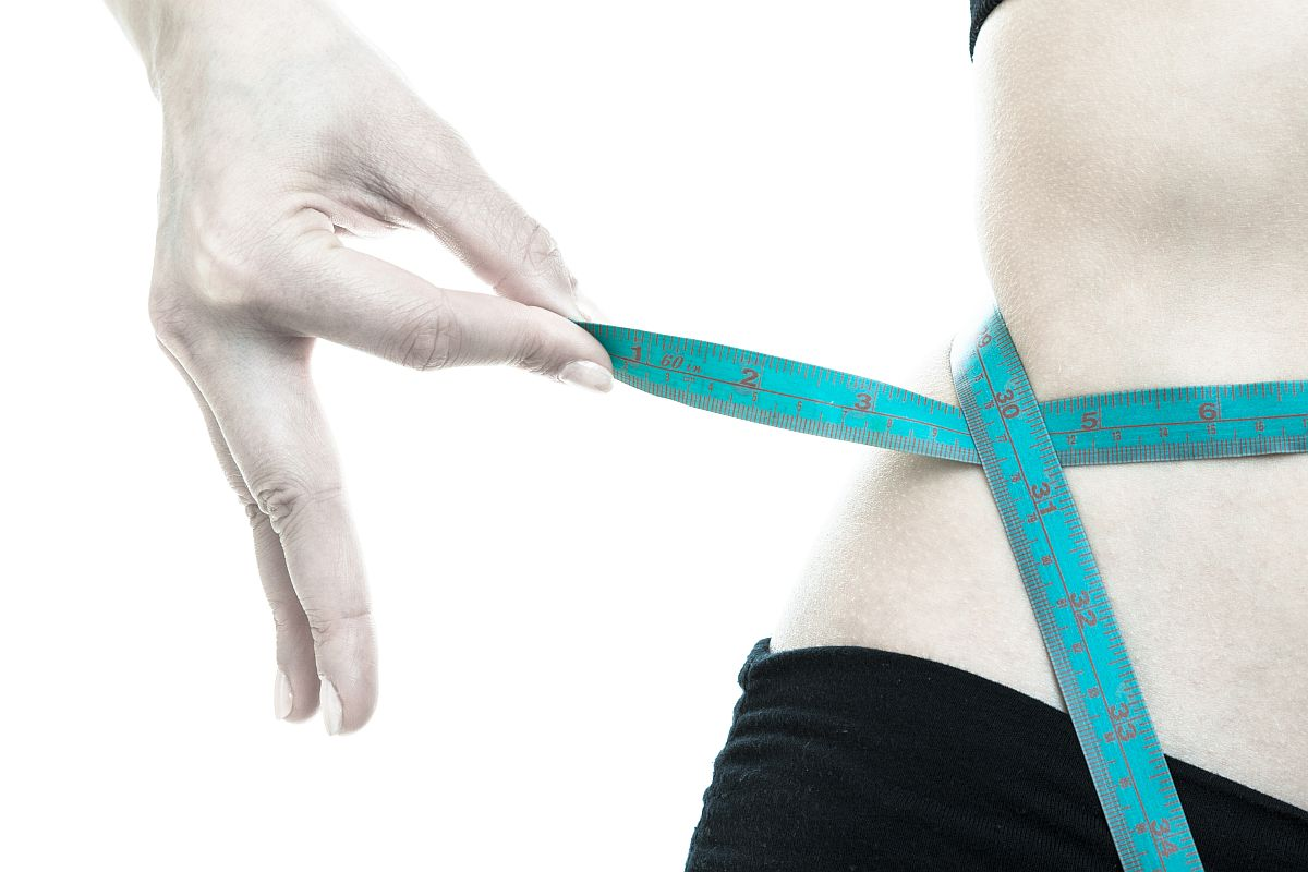 Weight Loss. Blue Measuring Tape On Woman Body