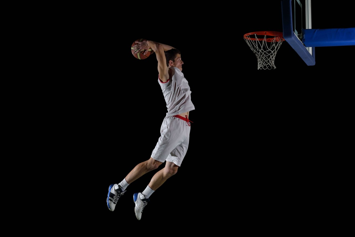basketball game sport player in action isolated on black backgro