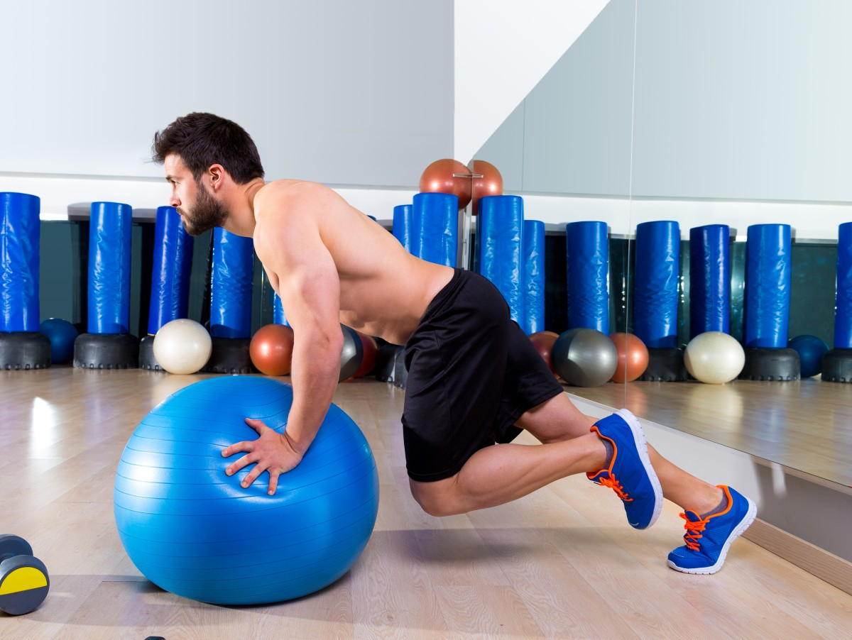 Fitball abdominal push ups Swiss ball man one single leg pushup